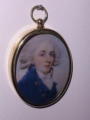 Portrait Miniature of Georgian gentleman wearing  blue jacket in  brass bezel.
