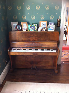 Upright-Walnut-Piano-G-A-Buckland-Co