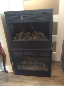 Electric fireplace—heater  100.00 each (2).     Hardly used