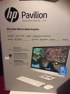 Brand new all in one hp pavilion 24-r159c.  750$ firm