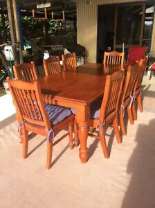 7 seater wooden dining setting