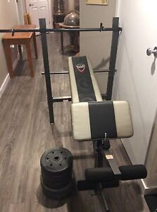 Cap strength workout bench with barbell and weights