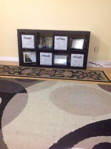 IKEA kallax shelf with four baskets and hallway area rug