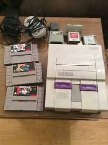 Vintage Super Nintendo system with 3 games