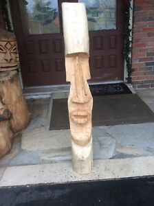 Chainsaw carved Easter Island style head