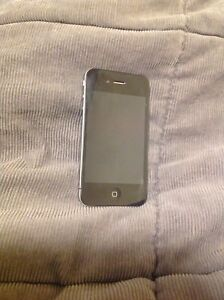 iPhone 4s with case and charging dock.