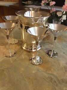 Silver ice bucket and champagne glasses