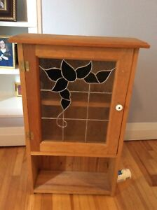 Pine cupboard with stained glass door
