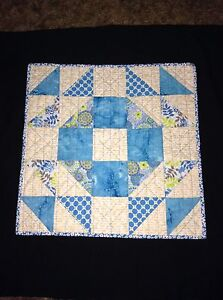Hand made quilted table topper.
