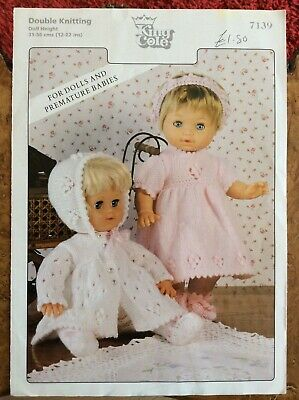 Dolls knitting patterns.cardigans.hats.booties.dress.height 12-22 inches.DK.