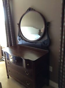 Antique lady's dresser.  Excellent condition, dark stain.