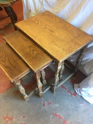 An oak nest of three occasional tables