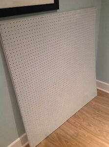 Peg board painted very light blue