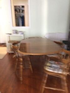 Kitchen table and six chairs for sale.
