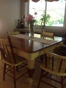 Antique table and four chairs.