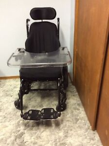 Tilting wheel chair with table