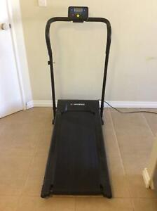 Treadmill by Confidence Fitness.