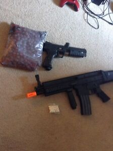 Airsoft and paintball gun with  ammo