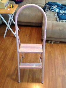 Pink ladder with paint on it