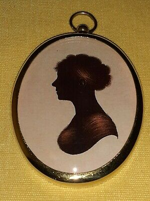 Portrait Miniature in silhouette of a young lady framed in an oval brass bezel