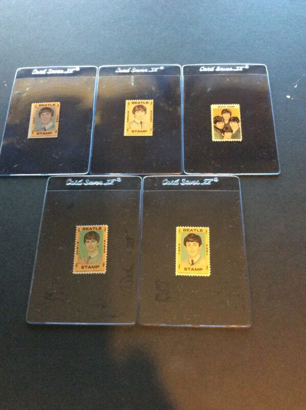 BEATLES 1964 HALLMARK STAMPS- FULL SET OF 5 STAMPS WITH PLASTIC HOLDERS INCLUDED