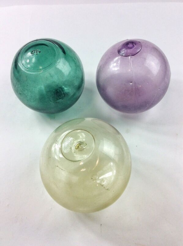 3 Antique blown glass fishing net floats marked