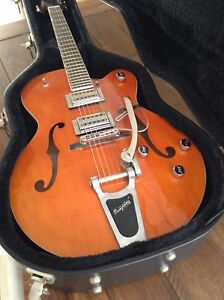 Mint Gretsch G5120 electromatic archtop and hard case. $700.