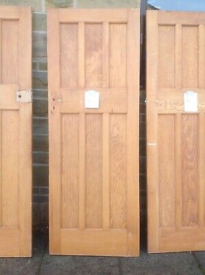 A pair of 1930s solid pine pannelled door