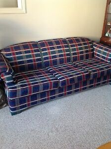 Matching plaid couch and love seat