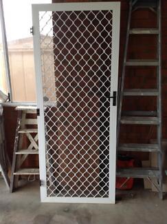 Hinged white security door