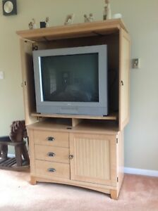 Attractive TV cabinet with TV.