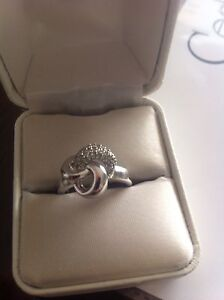 One ladies swirl claw set diamond ring!
