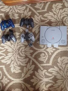 PlayStation one and 21 games and 4 controllers