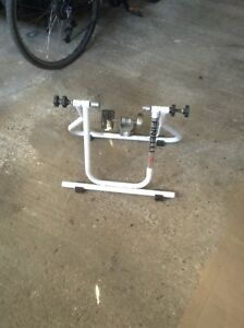 Bicycle training stand $40.00.      384 9316