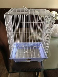 bird cage with food and toys for 25$