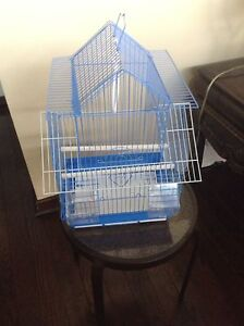 Bird cages new round one is 30$
