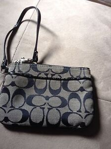 Coach wristlet, black and white, great condition