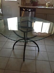 Large glass table with leather chairs