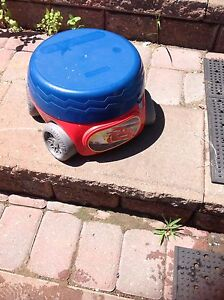 Nice potty in a car shape with stationed tires for $10