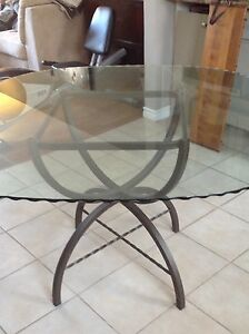 Glass topped table and leather chairs