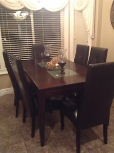 Beautiful solid wood dining-table with 6 leather chairs