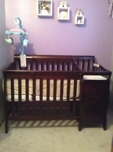 Mini crib with attached change table