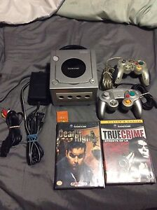 Nintendo GameCube with 2 controllers and games