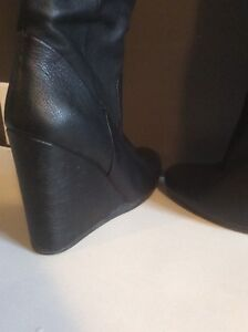 Tall black leather boots size 8.5