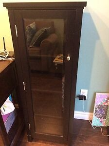 Black cabinet with glass front