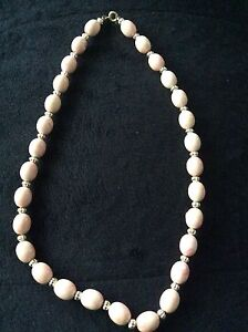 """20""""  light pink with gold coloured beads"""