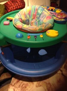 Excellent /gorgeous musical excersaucer for $25 only.