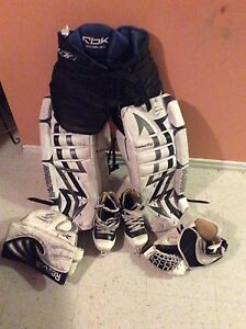 2 incomplete sets of goalie equipment (peewee & bantam)