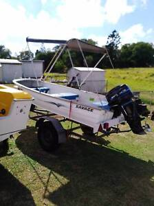 12 foot savage boat with 18hp motor and trailer all registered