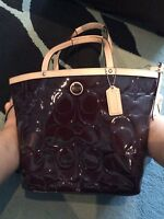 Brown patent-leather authentic COACH purse